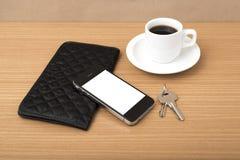 Chiave e portafoglio del telefono del caffè Fotografia Stock