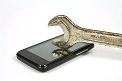 Chiave e un telefono cellulare Fotografia Stock