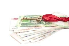 Chiave a successo su soldi internazionali Immagine Stock