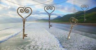 chiavi del cuore 3D che galleggiano sopra la costa di mare Fotografia Stock