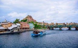 CHIBA, JAPAN: Mediterranean Harbor attraction with volcano in background in Tokyo Disneysea located in Urayasu, Chiba, Japan. Mediterranean Harbor attraction Royalty Free Stock Photos