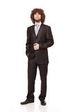 Chic business. Young businessman wearing a chic suit posing and looking at camera isolated on white background Royalty Free Stock Images