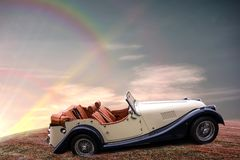 Chic convertible with a luxurious cockpit. Against beautiful sunset sky with amazing colorful clouds, evening light, the last rays of the setting sun and stock image