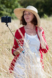 Chic countryside selfy for mature woman's vacation memories Royalty Free Stock Photos