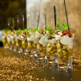 Chic dessert. Minimalistic dessert in a shot glass with fruit, ice-cream and strawberries royalty free stock photos