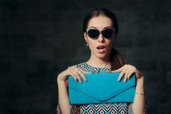 Elegant Woman with Retro Cat Eye Sunglasses and Clutch Purse stock photos