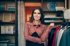 Fashionable Girl in Elegant Vintage Clothing Store. Chic fashionable woman in a clothes shop looking for new garments Royalty Free Stock Photo