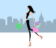 Chic Girl Walking With Shopping Bags in the City Stock Image
