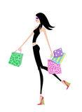 Chic Girl Walking With Shopping Bags Royalty Free Stock Photography