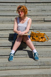 Chic lady. Preety young woman standing on stairs on a sunny day Stock Images