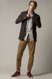 Chic man in white skirt and brown jacket and trousers. Chic man in white skirt and brown jacket and trousers Stock Photos