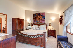Chic master bedroom features vaulted ceiling Royalty Free Stock Photos