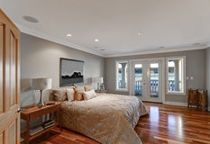 Chic master bedroom interior with private balcony Royalty Free Stock Images