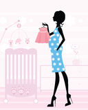 Chic mom-to-be in her baby`s nursery. Chic pregnant mom-to-be in her upcoming baby`s nursery Stock Photo