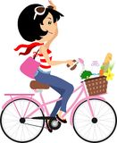 Chic Paris Girl in bike, cute  black hair woman in bicycle with groceries clip art Royalty Free Stock Image