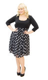 Chic in polka dots dress - beautiful woman smiling Stock Image