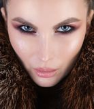 Chic portrait shot of a girl with strong makeup and fur Royalty Free Stock Photos