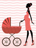 Chic pregnancy. A chic pregnant woman with baby carriage Stock Photo
