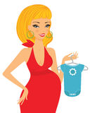 Chic pregnant blond shopping for her future baby Royalty Free Stock Images