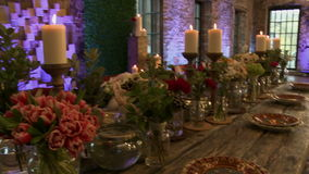 Chic restaurant decorated to celebrate wedding. View of chic restaurant decorated to celebrate wedding stock video