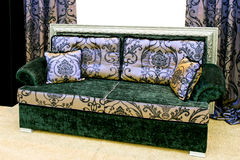 Chic sofa. Chic colorful sofa with old style fabric Stock Images