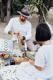 Bohemian hipster couple drinks wine stock photography