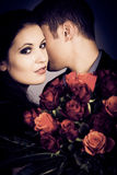 Chic Valentine`s Couple With Bouquet Of Roses Stock Image