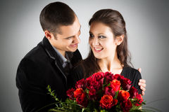 Chic Valentine`s Couple With Bouquet Of Roses Stock Photos