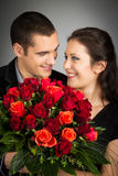 Chic Valentine`s Couple With Bouquet Of Roses Stock Photo
