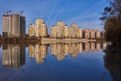 Chic View of the west of Krasnodar from the Kuban River in the winter in the golden hours. New high-rise buildings and clear blue royalty free stock image