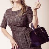 Chic woman with handbag. Fashion clothing people concept. Chic woman with black, leather handbag. Female wearing elegant dress Royalty Free Stock Image