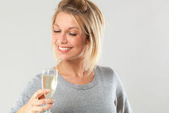 Chic young blond woman enjoying drinking flute of bubbly wine Royalty Free Stock Photography