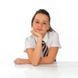 Chica joven aburrida en uniforme escolar Fotografía de archivo