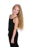 Chica joven adorable contra el blanco Foto de archivo