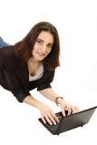 Chica joven agradable con el netbook Foto de archivo libre de regalías