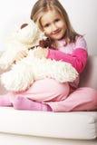 Chica joven agradable en color de rosa Imagenes de archivo