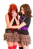 Chica joven atenta que calma a su novia triste Fotografía de archivo
