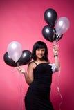 Chica joven atractiva con los globos del cumpleaños Fotografía de archivo libre de regalías