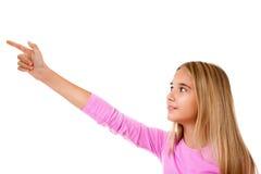 Chica joven atractiva que señala su finger Aislado Fotografía de archivo libre de regalías