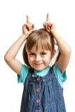 Chica joven bastante dulce que hace al buen diablo aislado Imagenes de archivo