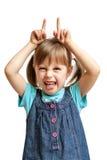 Chica joven bastante dulce que hace al diablo malvado aislado Fotografía de archivo libre de regalías