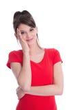 Chica joven bonita aislada en una camisa roja. Imagenes de archivo