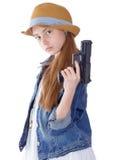 Chica joven bonita con una sentada del sombrero Fotografía de archivo libre de regalías