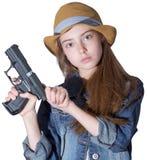 Chica joven bonita con una sentada del sombrero Imagen de archivo libre de regalías
