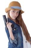 Chica joven bonita con una sentada del sombrero Foto de archivo libre de regalías