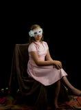 Chica joven bonita en el primer de la máscara del carnaval Imagen de archivo libre de regalías