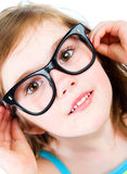 Chica joven bonita en vidrios Foto de archivo libre de regalías
