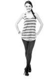 Chica joven bonita pulso una actitud elegante Fotos de archivo