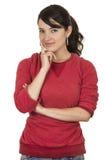 Chica joven bonita que lleva la presentación del top rojo coqueta Fotografía de archivo libre de regalías