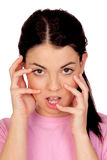 Chica joven bonita que toca su cara Fotografía de archivo libre de regalías